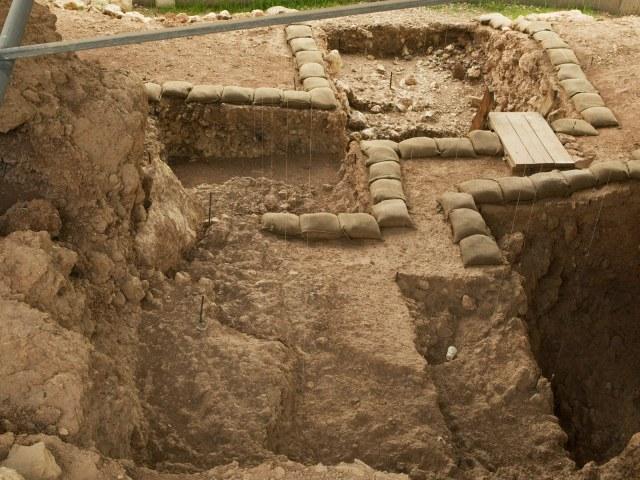 Quesem cave a tan dirt filled excavation site