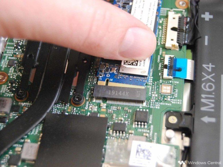 Insert the new SSD into the slot.