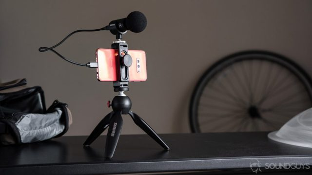 A picture of the Samsung Galaxy S10e clipped into the Manfrotto Pixi tripod with the Shure video kit microphone, a runner-up for the best mics for YouTube list, attached.