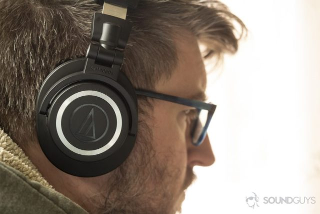A photo of the Audio-Technica ATH-M50xBT on a man's head - Best over-ear headphones under $100