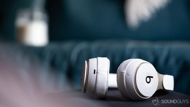 A photo of the Beats Solo Pro on-ear noise cancelling headphones lying on a black surface with the Lightning input in focus.