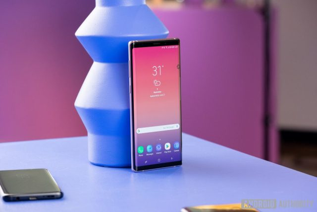 A picture of the Samsung Galaxy Note 9 against a geometric blue object.