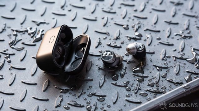A picture of the Plantronics BackBeat Pro 5100 true wireless earbuds outside of the case and surrounded by water splashes.