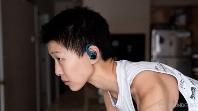 A picture of the Plantronics BackBeat Fit 3200 true wireless workout earbuds worn by a woman on a bike in profile.