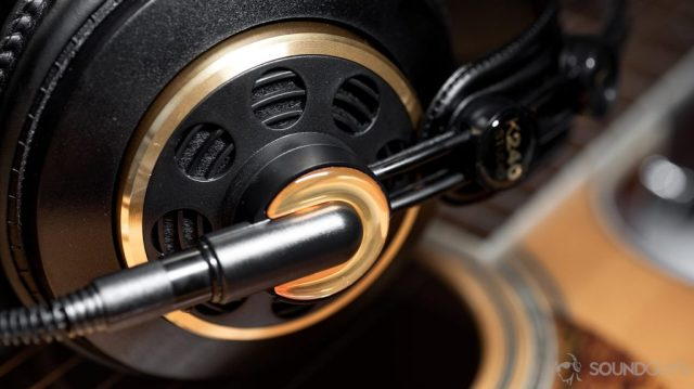 A photo of the AKG K240 Studio semi-open headphones with the left ear cup in focus.