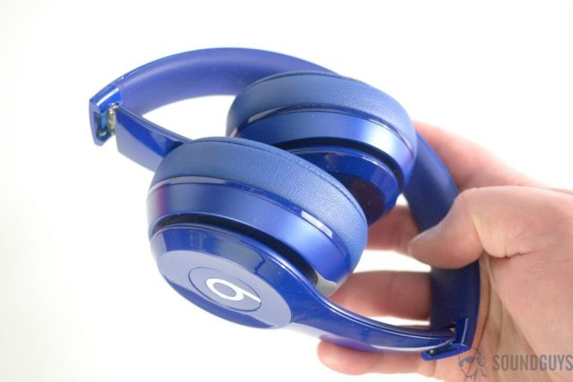 Pictured are the blue Beats Solo 2 in hand folded at the hinges.