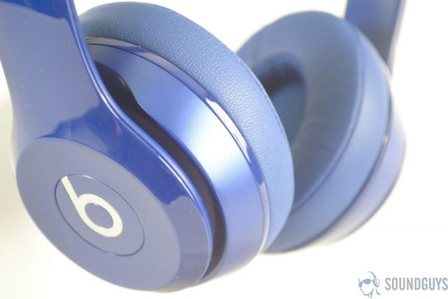 Shot of the Beats logo on the side of the Beats Solo 2 headphones in blue.