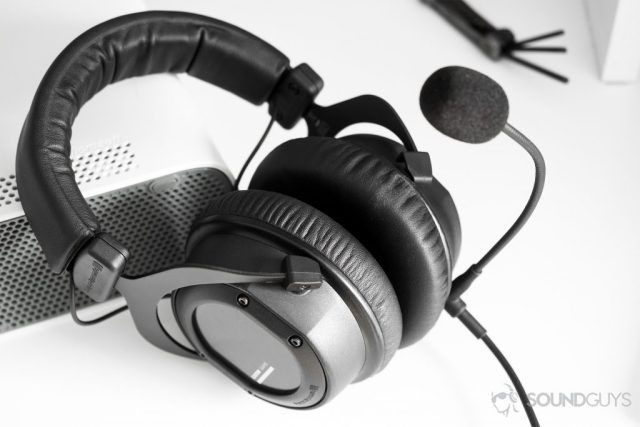 Beyerydynamic CUSTOM Game headset leaning on a white Xbox 360 with a universal Allen wrench key in the background.