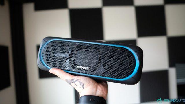 Sony SRS-XB40 Bluetooth speakers being held.