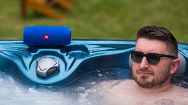 A photo of the JBL Charge 3 in use near a hot tub.