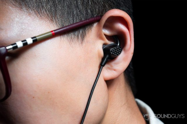 best wireless beats: A woman wearing the earbuds with a close-up of the ear to depict the fit.