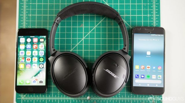 The Bose QuietComfort 35 II next to an Apple iPhone and a Google Pixel XL.