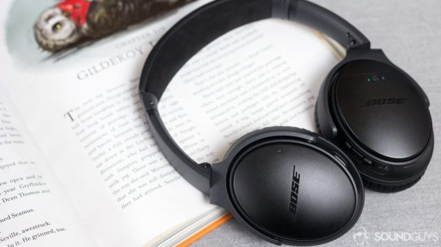 The Bose QuietComfort 35 II resting on an open book.