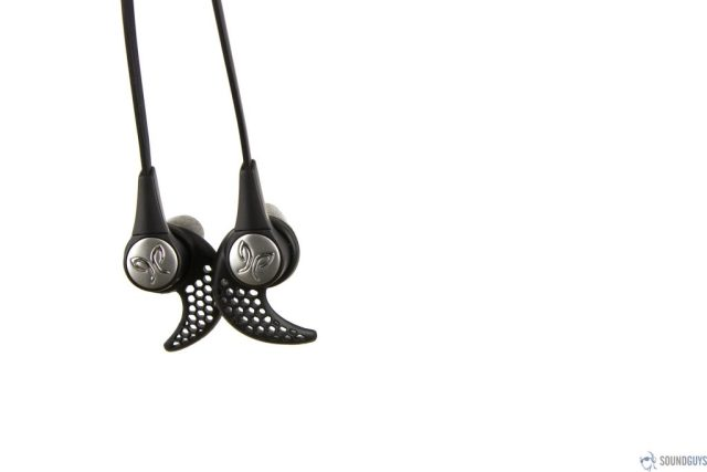 Pictured is the Jaybird logo on the back of ear earbud as they hang against a white background.