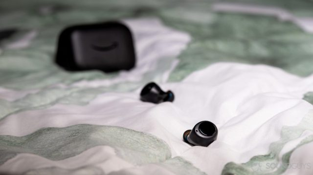 A picture of the Amazon Echo Buds true wireless earbuds outside of the charging case.
