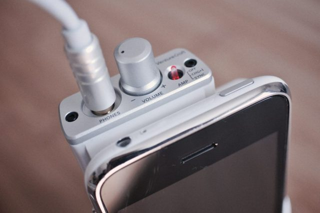 best headphones under $1,000: A photo of a headphone amplifier attached to a smartphone, shot by Flickr user mujitra.