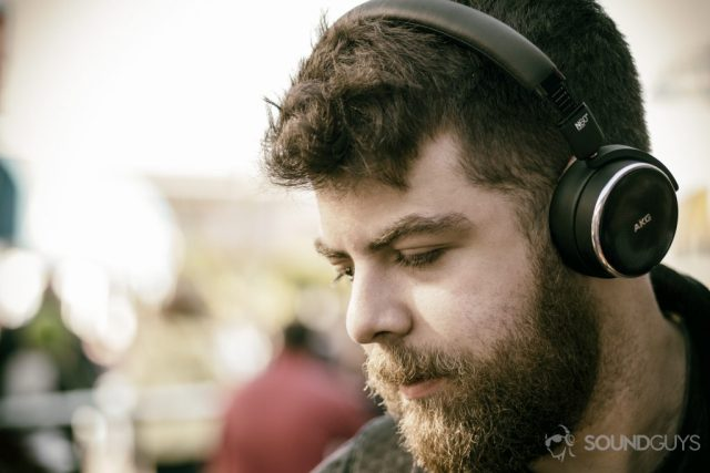 A photo of the AKG N60 NC on-ear headphones being worn by Adam Molina.