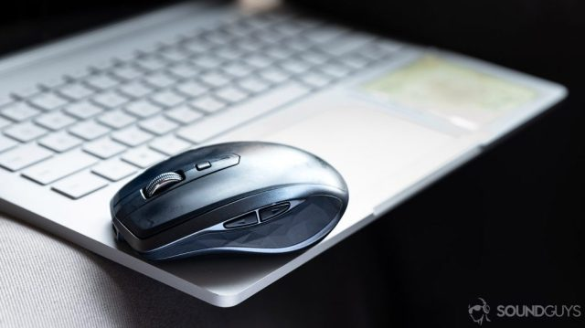 How to work from home with a Logitech MX Anywhere mouse placed atop a laptop.