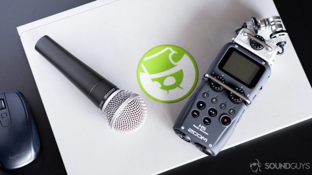 Shure SM58 microphone next to a Zoom H5 handheld voice recorder.