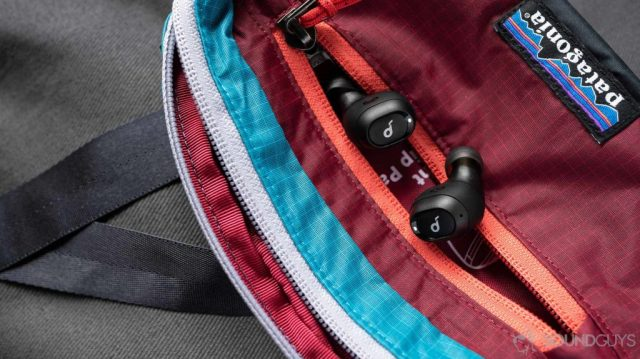 A picture of the Anker SoundCore Liberty Neo true wireless earbuds in a Patagonia fanny pack.