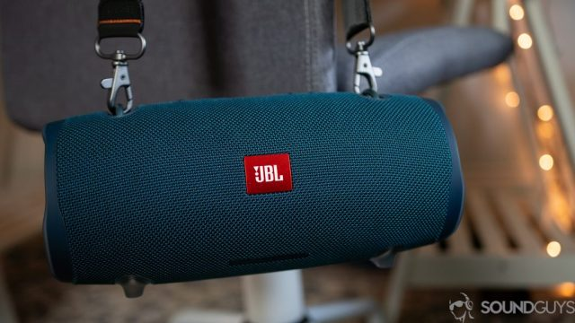 Shot of the JBL Xtreme 2 hanging from a gray chair thanks to the strap.