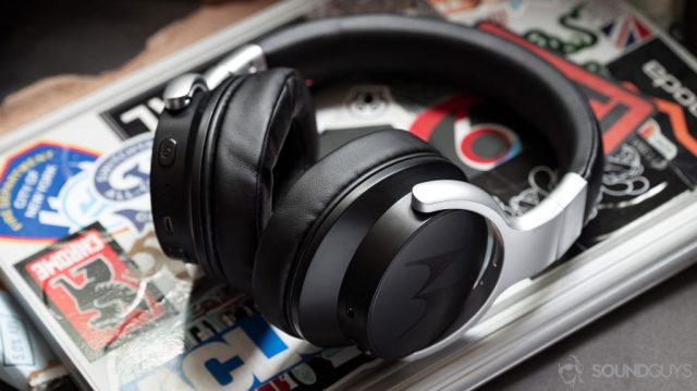 A photo of the Motorola Escape 500 ANC noise cancelling headphones lying flat on a Microsoft Surface Book laptop.