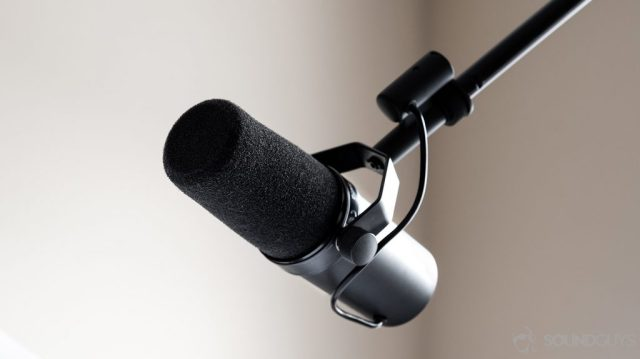 A photo of the Shure SM7B dynamic microphone attached to a stand.