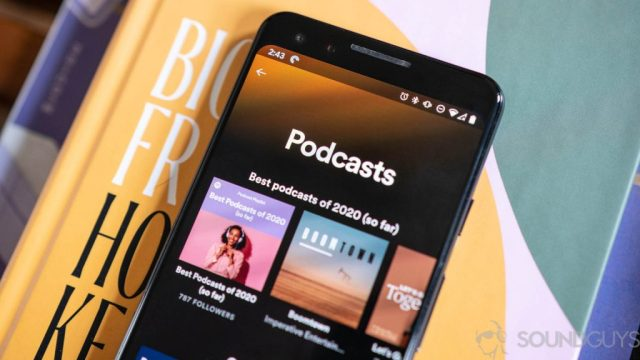 Close-up of podcast section on Spotify app in iOS.