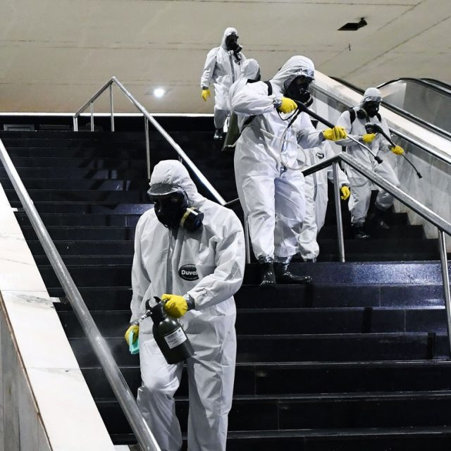 sanitation workers cleaning stairs