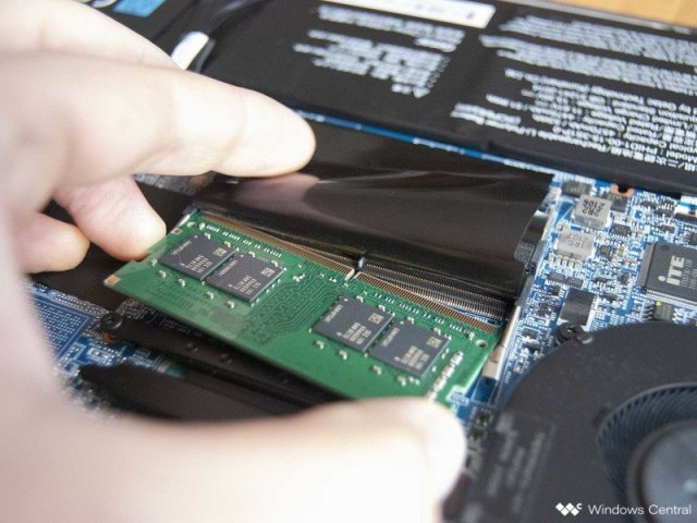 Slide the new RAM into the slot