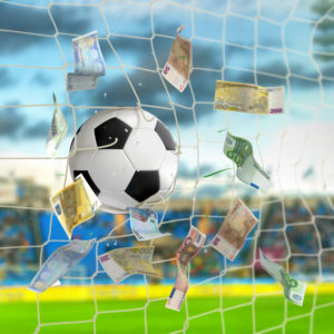 soccer ball in the net with euro banknotes