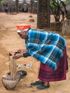 Zulu woman sieving sorghum & maize