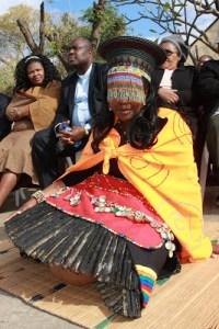 A zulu bride sitting on her grass mat