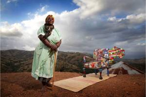 A Woza Moya crafter with a beaded chair