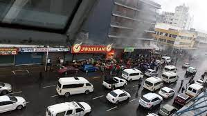 Protesters set three shops alight in Durban CBD