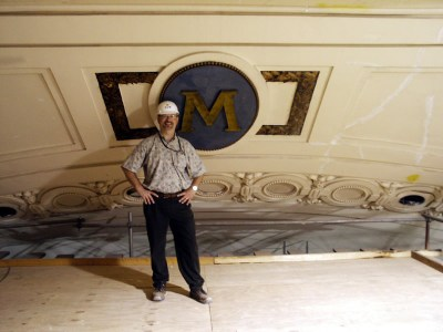 M on Ceiling with Staffer for Scale