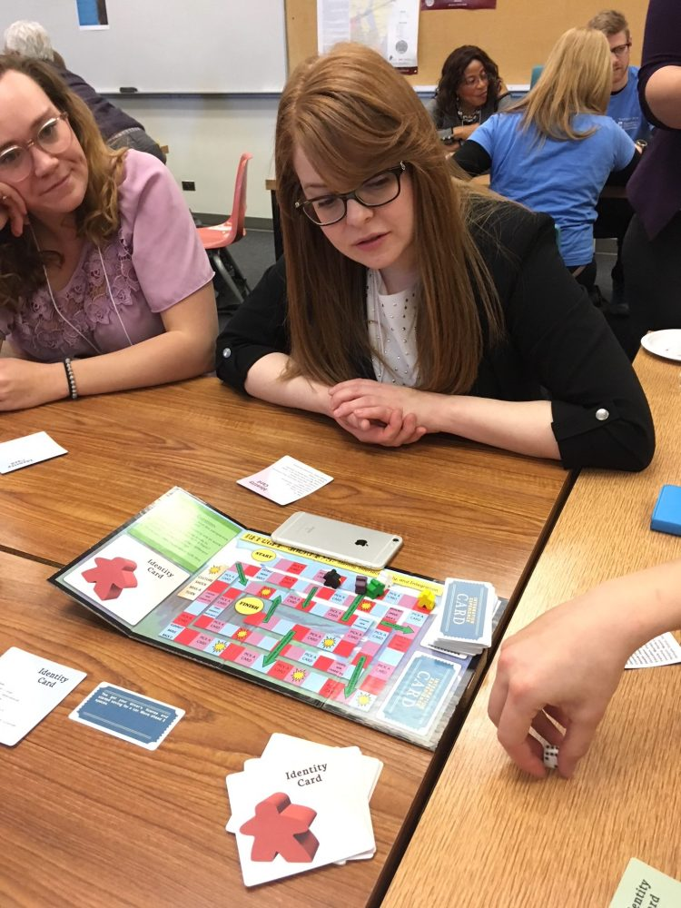 Michelle Lam's board game 'Refugee Journeys' in action.