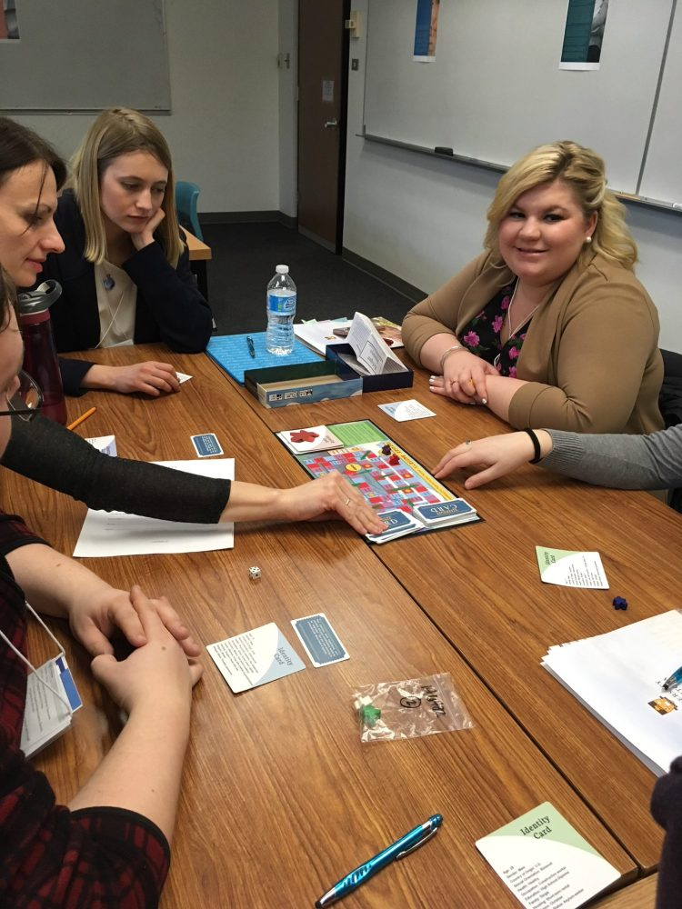 Michelle Lam's board game 'Refugee Journeys' in play.