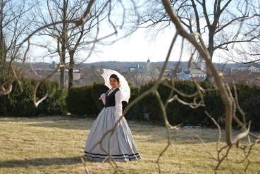 Laura posing in period costume.