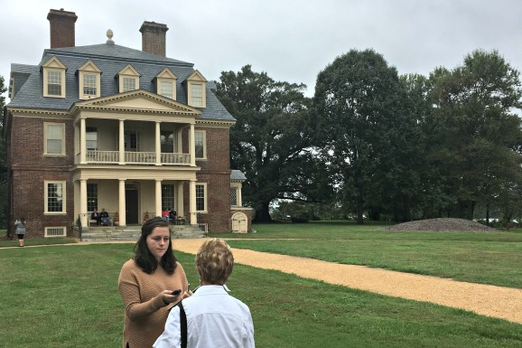 Christine MacKrell interviews a visitor at Shirley Plantation.