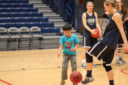 The UMW Women's Basketball team works with children from Stafford Junction to teach them about healthy living and college life. Photos by Julia Davis.