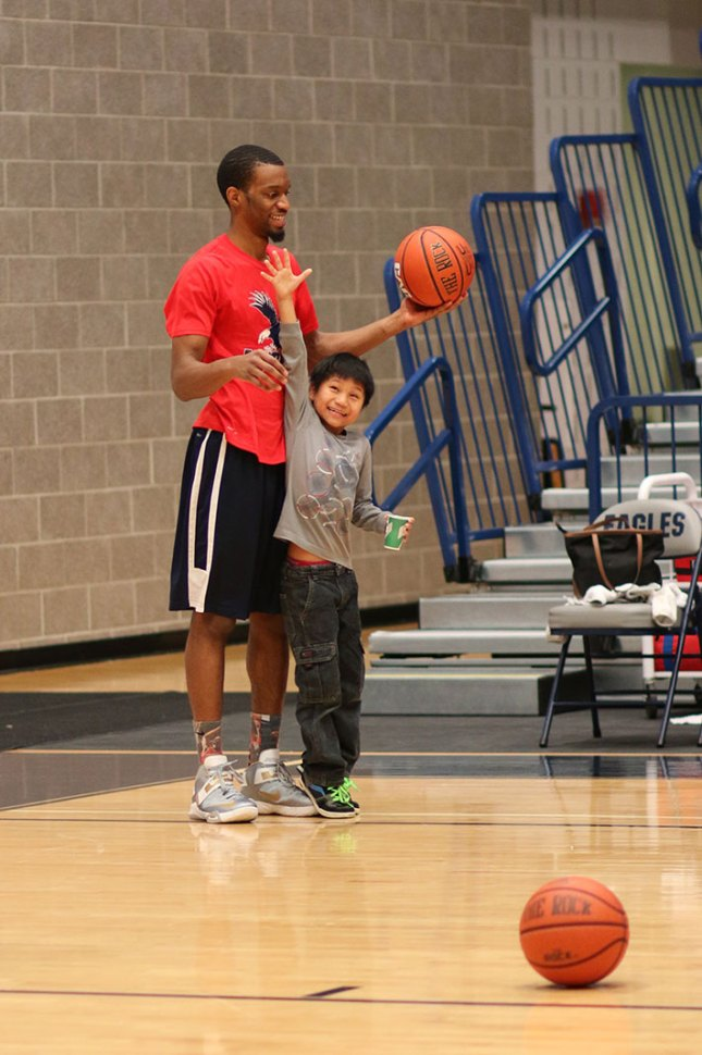 The UMW Men's Basketball team also participated in the day's events, teaching children about basketball.