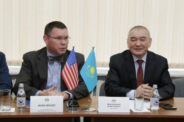 Consulate General of the United States in Almaty Mark Moody (left) and al-Farabi Kazakh National University First Vice Rector Mukhambetkali Burkitbayev have expressed gratitude to faculty members from UMW's Department of Political Science and International Affairs for contributing to a book drive headed by Professor Steve Farnsworth. The books were given to al-Farabi University in Kazakhstan.