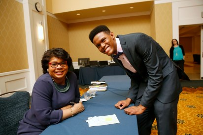 Journalist April Ryan posed for photos with students during a book signing that followed her address at the University of Mary Washington Thursday night. Photo by Suzanne Rossi