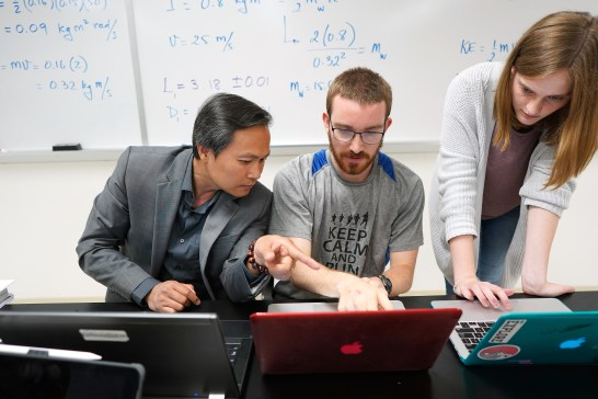 Nguyen is known for pushing students toward research (and for ordering pizza in class). Photo by Suzanne Rossi.