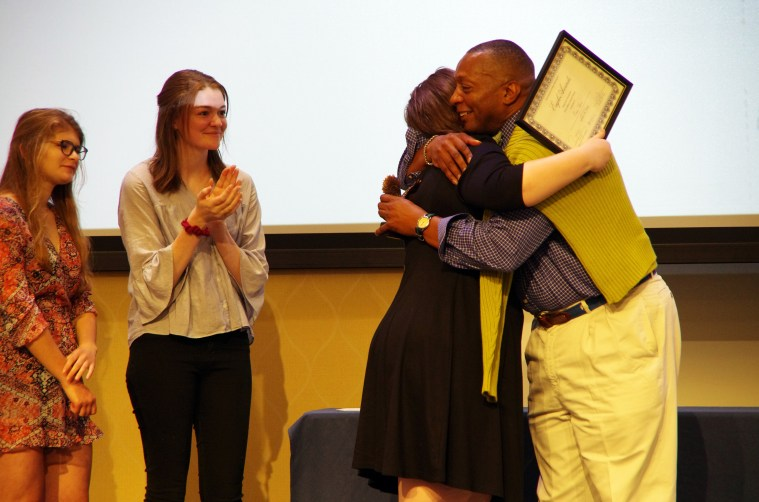 Erin Shaw hugs Cedric Rucker, associate vice president and dean of Student Life, at the Eagle Awards ceremony. Shaw won the Grace Mann Launch Award on Thursday night. Photo by Noah Stroble.