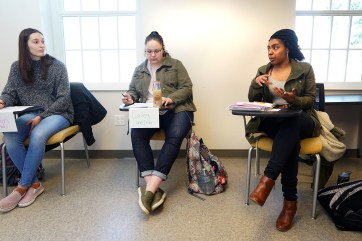 (Left to right) Kaitlyn McClung, Cailey Epperson and Maya Moore feel free to share their opinions during a chapter discussion based on a new textbook written by UMW professors Mindy Erchull and Miriam Liss, along with a colleague. Photos by Suzanne Carr Rossi.