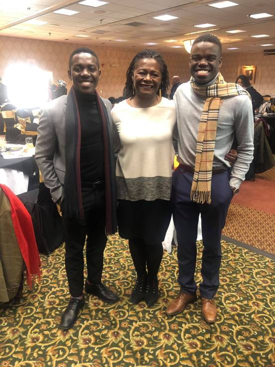 Nehemia Abel (R) with his brother, Alexander Abel, a George Mason University alumnus, with Sabrina Johnson, UMW's vice president for equity and access and chief diversity officer. Aided by StartUpUMW, the brothers founded their own nonprofit, UBUMWE, which helps local Burundian youth. Photo courtesy of Nehemia Abel.