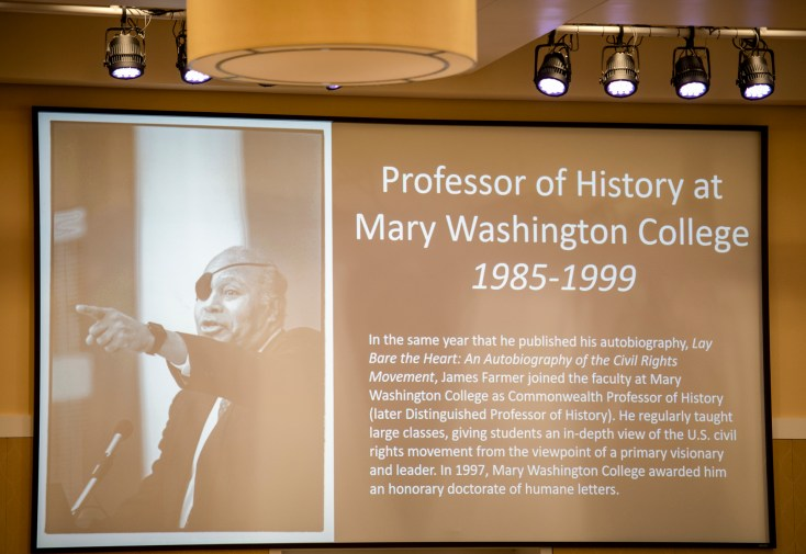 A slideshow showcased meaningful milestones and significant accomplishments throughout Dr. Farmer's life. Photo by Tom Rothenberg.