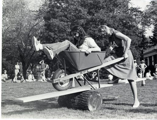 Two students compete in the Devil Goat Day wheelbarrow contest in 1977. Photo courtesy of Simpson Library Special Collections.